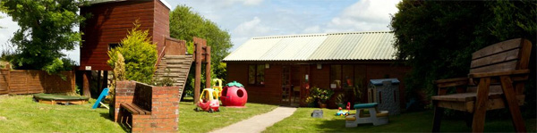 Play area in sunshine at Smythen Farm Holiday Cottages in North Devon.