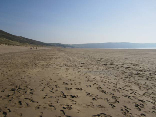 Footprints in sand on Woolacombe beach in North Devon